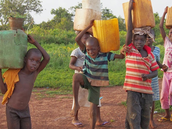 Kids in Mole with their water buckets.
