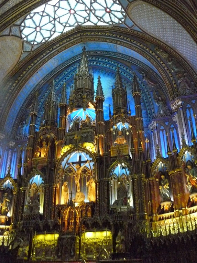 The intricate religious statues and stained glass windows of Notre-Dame Basilica's breathtaking altar.