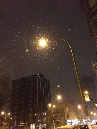 Snow falls in Montreal at the start of the All Nighter celebration.
