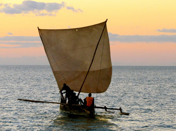 An outrigger canoe off the coast of Madagascar. photos by Jean M. Spoljaric.