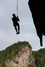 A rock climber hangs over Tonsai Bay, Thailand. Eloise Horsfeld photos.