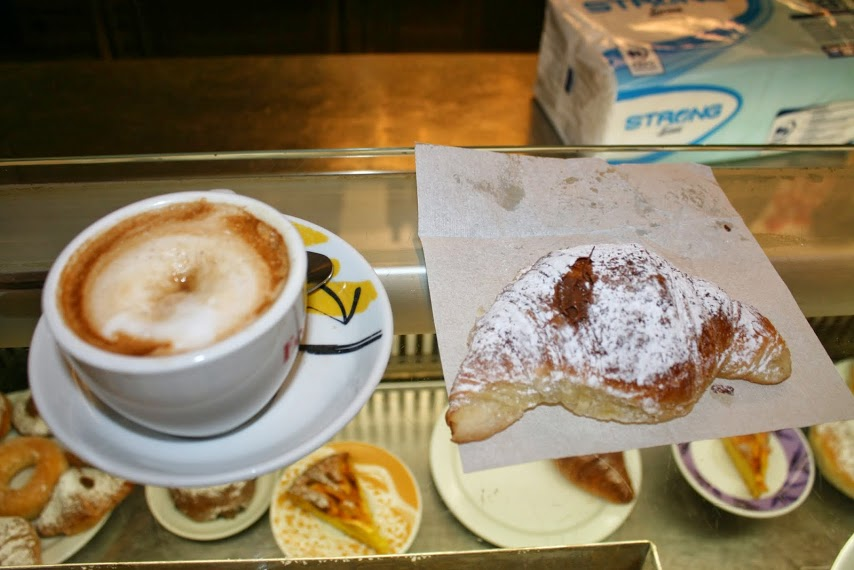 Cornetto and cappuccino: Breakfast in Rome.