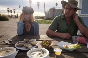 Rebecca Chambers, a regular customer with Mark Rey of the Jolly Oyster on the beach in San Buenaventura State Park.