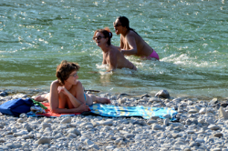 Nude bathers by the river in Munich.