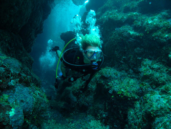 Sonja diving in Honduras.