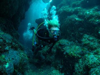 Sonja diving in Honduras.