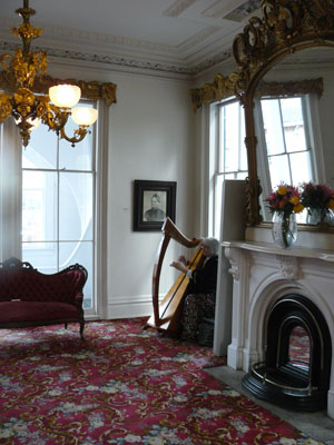 Susan Wilzer plays that harp at the Bellamy Mansion in Wilmington.