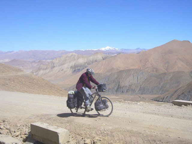 Cycling on the barren Tibetan plateau, near Mount Everest.