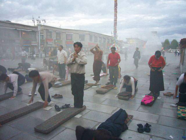 Daily prayers in front of the Jokhang Temple, Lhasa.