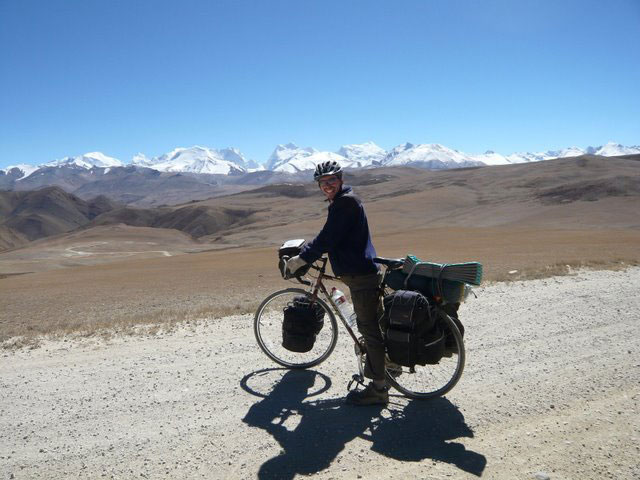 Biking at the top of the Himalayas - photo by Rebeccas Gados. Click on photo to return to Rebeccas Gados' story about biking in Tibet.