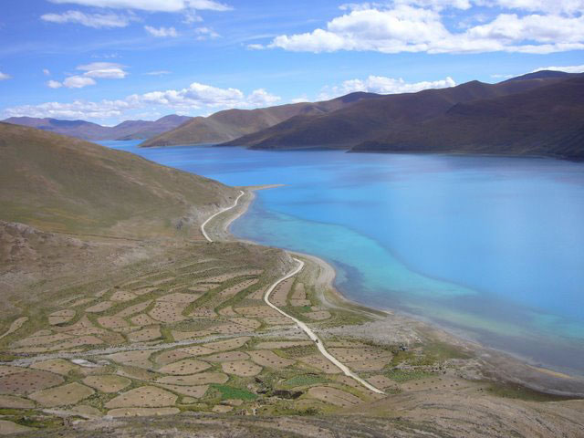 Yamdrok Lake in Tibet - photo by Rebecca Gados. Click on photo to return to Rebecca Gados' story about biking in Tibet.