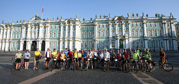 Tour d' Afrique cyclists outside of Winter Palace in St. Petersburg, the start of the Amber Route. Photo by Paul McManus.