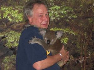 Kent St. John with a koala in Australia.