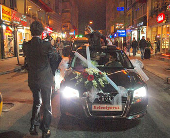 The newlyweds' car leads a Kurdish wedding procession through the streets of Istanbul. Photos by David Joshua Jennings.
