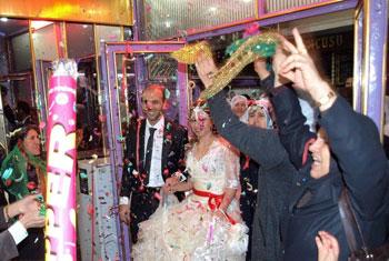 The wedding couple enters.