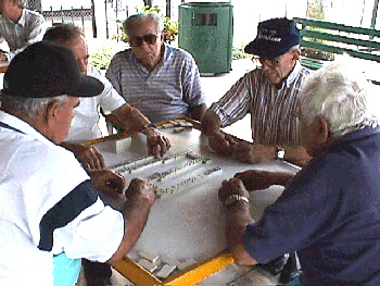 Abuelitos playing another intense game of domino in Domino Park. Photo by School of Education, University of Miami.