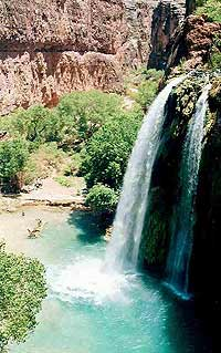 Plunging 200 feet into the swimming hole below, Mooney Falls is the most majestic of the three waterfalls.