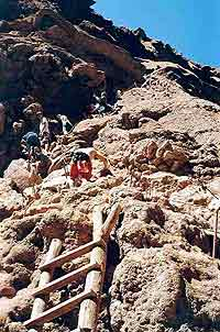 Campers make their way down the treacherous path to Mooney Falls.