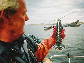 Lobsterman with his catch off of Tierra del Fuego.