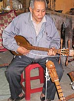 Elderly musician playing in a Chiang Mai club.