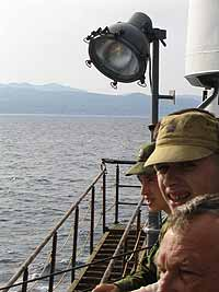Travelers weary from the ferry watch Sakhalin approach.