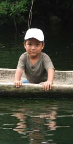 Mayan Boy in Dugout on Rio Tatin