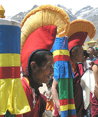 Monks don their ceremonial headgear to greet the Dalai Lama at Kungri.