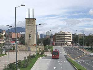 A bus zips through Bogota on the TransMilenio.