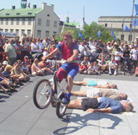 An acrobat performs in the city center