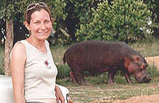 Marie poses a little too close to a hippo.