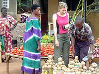 The author shops for vegetables in Kampala.