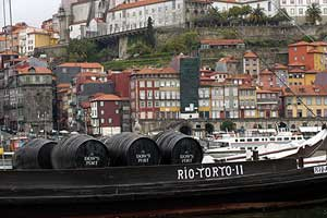 Historical boats on the River Douro show how Porto's famed port wine was transported down from the hills.