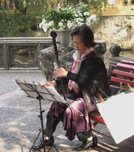 A woman plays a Chinese two-string fiddle known as an ehru in the park in Macau. Photos by Kent E. St. John