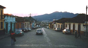 Dawn comes usover the mountains in San Cristobal - photo by Richard Arghiris