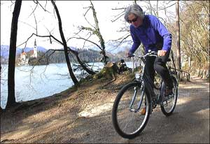 The author biking the six-mile path around Lake Bled. Photo by Reid Bramblett, reidsguides.co