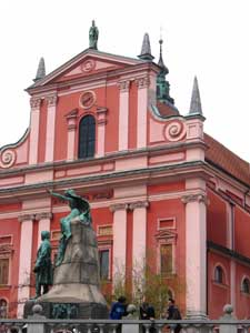 A monument to France Preseren, Slovenia's greatest poet, flanks the vivid Church of the Annunciation at Preseren Square in Ljubljana. Photo by Christine H. O'Toole
