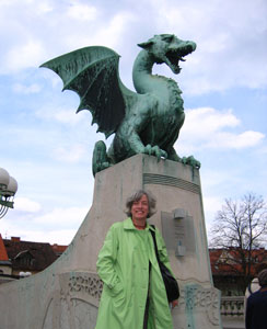The author at Dragon Bridge -- The dragons crowning the bridge are the symbol of Ljubljana. photo by Susan McKee, susanmckee.com