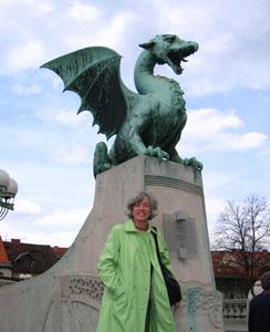 The author at Dragon Bridge -- The dragons crowning the bridge are the symbol of Ljubljana. photo by Susan McKee, susanmckee.com
