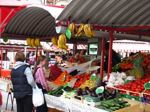 Ljubljana market: Flowers, fresh fruit, and bear sausage tempt the crowds by the Market Colonnade. Photo by Christine H. O'Toole