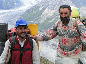 The author's guide, Sajad, with one of the porters