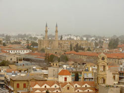 Mosque in the distance, with twin minarets, that was once a cathedral. Max Hartshorne photos.