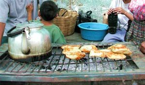 """""""Chuchos"""" are made of corn meal with a bit of meat and gravy."""