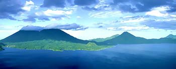 Three enormous volcanos form the lake's southern shore. Atitlan, Toliman and San Pedro. Lake Atitlan Guatemala