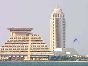 A paraglider sails past the Sheraton