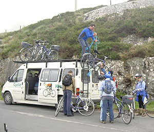 Our guide, John Heagney, loads the bikes onto the van.