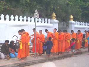 A daily ritual in Luang Prabang: monks receiving offerings from the faithful - photos by S. Michael Scadron