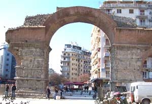 The Arch of Galerius, studded with Roman stone carving, jumps out of the past at Kamara.