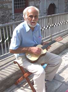 A  minstrel plucks away, downtown Thessaloniki.