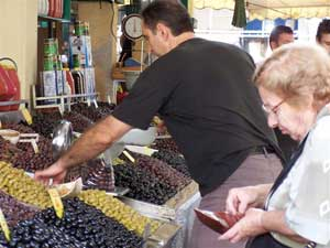 Varieties of the all-important Greek staple, the olive, on sale in the open market.