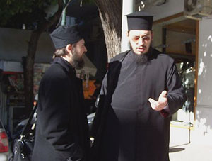 Two Orthodox priests compare notes, downtown Thessaloniki.